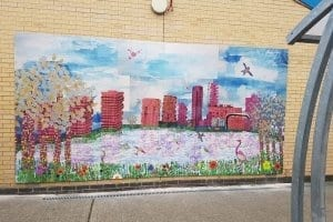 Children's printed artwork installation on school wall