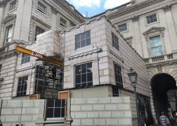 Building wrap installation to cover scaffold on Somerset House